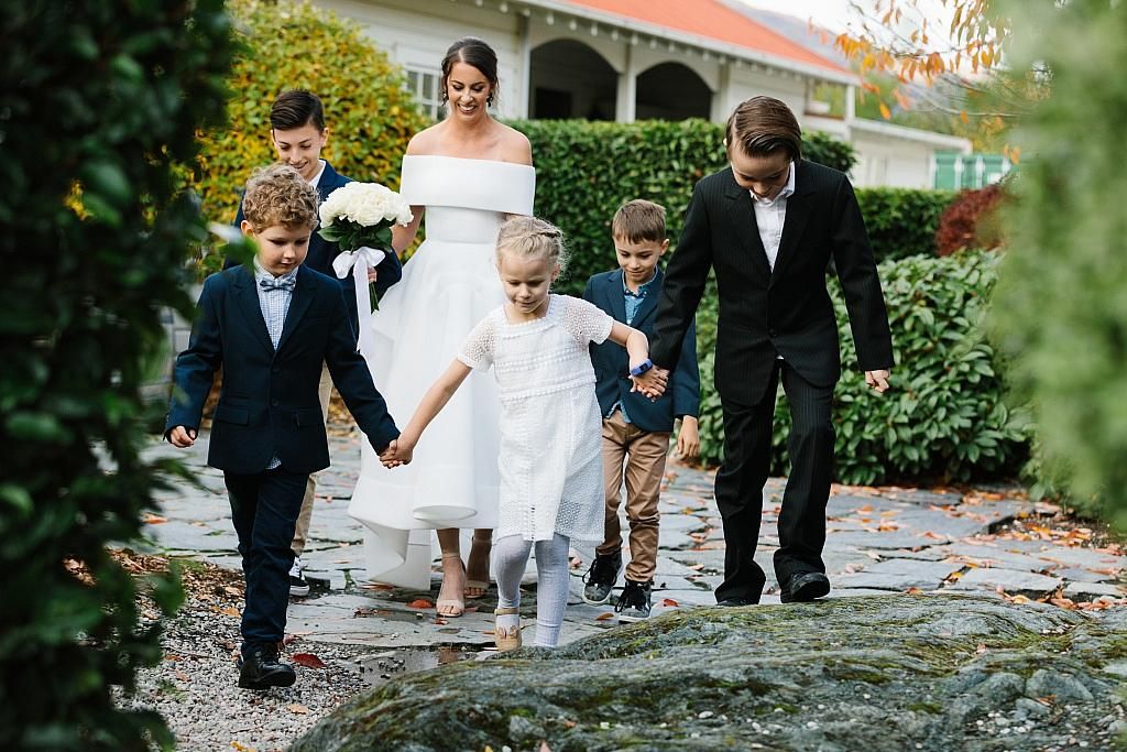 Bride walks with all her families children down the aisle